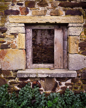 An old window featuring hewn sandstone (note the hand chisseld marks_ and local rocks.