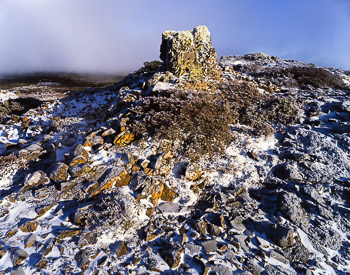 The Cracked Dolerite Depicts the recurrent freeze, thaw cycle of this high alpine moorland
