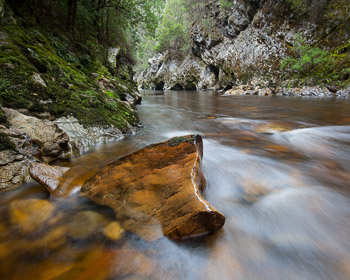 The rushing waters of the Franklin River polish the quartzite to a glass like finish. The narrow Indaba Passage is the last small gorge before the Franklin doubles in size after its junction with the Collingwood River.